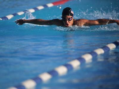 Female Swimmer Competing in a Butterfly Race--Photographic Print
