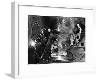 Female Welders Welding Seams on Deck Section of an Aircraft Carrier under Construction at Shipyard-Margaret Bourke-White-Framed Premium Photographic Print