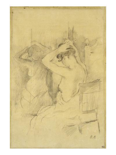 Femme Nue De Dos femme demi-nue,vue de dos se coiffant une glace reflétant son corps