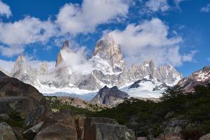Monte Fitz Roy framed by rocks and trees near Arroyo del Salto in Patagonia, Argentina, South Ameri by Fernando Carniel Machado