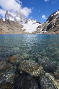 Stones seen through the water of Lago de los Tres featuring Monte Fitz Roy in the background, Patag by Fernando Carniel Machado