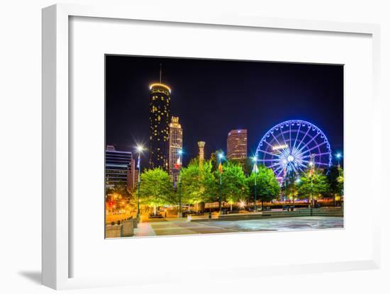 Ferris Wheel and Buildings Seen from Olympic Centennial Park at Night in Atlanta, Georgia.-Jon Bilous-Framed Photographic Print