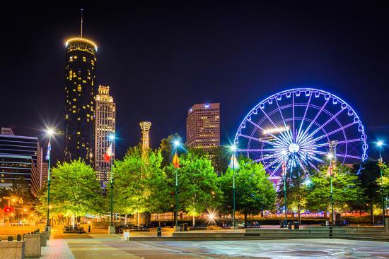 Ferris Wheel and Buildings Seen from Olympic Centennial Park at Night in Atlanta, Georgia.-Jon Bilous-Photographic Print