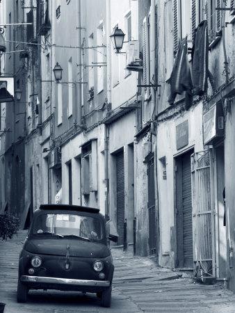https://imgc.artprintimages.com/img/print/fiat-driving-in-narrow-street-sassari-sardinia-italy_u-l-p38iro0.jpg?p=0