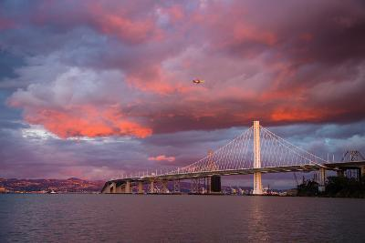 Fiery Clouds and Jet Plane at Bay Bridge, Oakland--Photographic Print