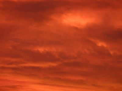 Fiery Red and Orange Sunset Illuminating the Night Sky--Photographic Print