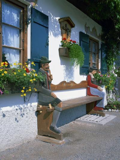 Figures Carved on a Bench on a Decorative House Front at Garmisch Partenkirchen in Bavaria, Germany-Gavin Hellier-Photographic Print