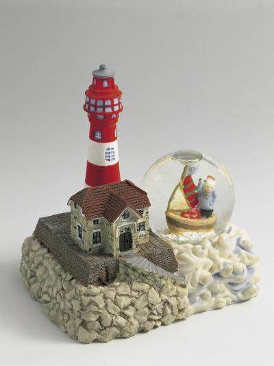 Figurine of a Lighthouse with a Snow Globe--Photographic Print