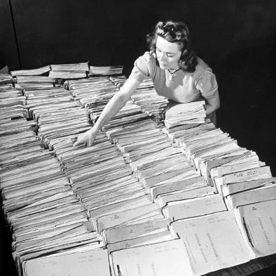 File Clerk at the Fbi Working with a Table Covered with Files--Photographic Print
