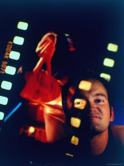 """Film Director Quentin Tarantino Framed by Projected Clip From His Movie """"Pulp Fiction""""-Ted Thai-Premium Photographic Print"""