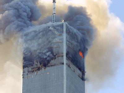 Fire and Smoke Billows from the North Tower of New York's World Trade Center September 11, 2001