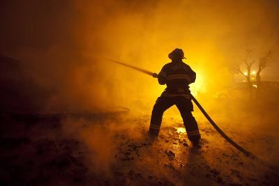 Fire Crews Work to Contain a Fire-Peter Dasilva-Photographic Print