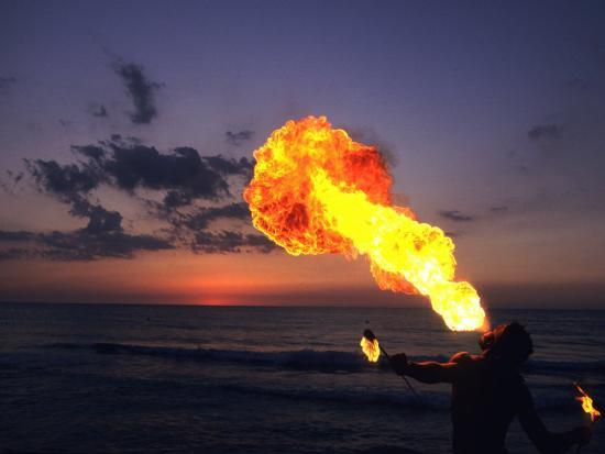 Fireeater at Sunset, Jamaica-Holger Leue-Photographic Print
