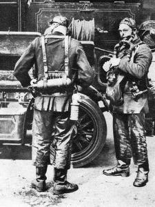 Firefighters Donning Smoke Helmets, Farringdon Street Rubber Works, London, 1926-1927