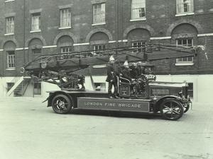 Firemen Aboard a Fire Engine, London Fire Brigade Headquarters, London, 1929