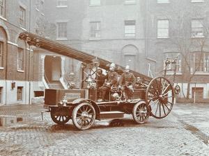 Firemen Aboard a Motor Fire Escape Vehicle, London Fire Brigade Headquarters, London, 1909