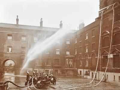 Firemen Demonstrating Hoses Worked by a Petrol Motor Pump, London Fire Brigade Headquarters, 1909--Photographic Print