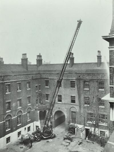 Firemen Demonstrating the Magirus Ladder, London Fire Brigade Headquarters, London, 1910--Photographic Print