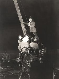 Firemen Raising Ladder on Firetruck