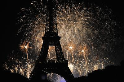 Fireworks Illuminate the Sky at the Eiffel Tower in Paris-Yoan Valat-Photographic Print