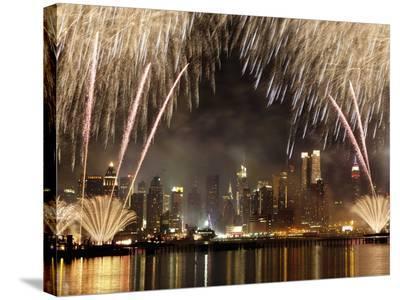 Fireworks on Manhattan, NYC-Michel Setboun-Stretched Canvas Print