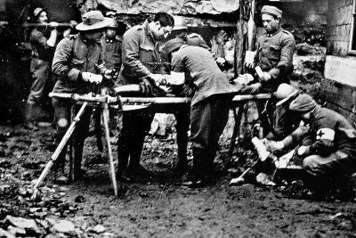 First Aid Given to a Wounded Soldier in the Front Lines During World War I--Photographic Print