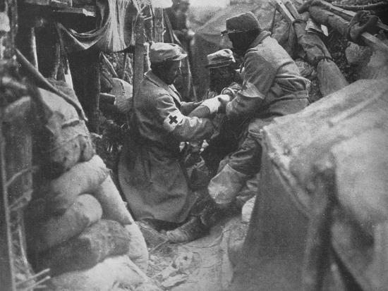 'First aid to a wounded man in one of the French trenches', 1915-Unknown-Photographic Print