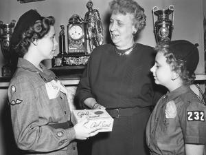 First Lady Bess Truman Purchases the First Box of Cookies to Start the Annual Girl Scout Fundraiser