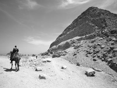 First Stepped Pyramid with Camel Rider, Egypt-David Clapp-Photographic Print