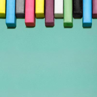 Creative Still Life of Multicolored Chalks Arranged in a Row Like Piano Keys