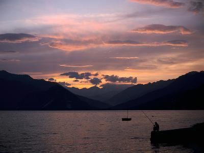 Fisherman at Sunset, Lake Maggiore, Italy-Peter Thompson-Photographic Print