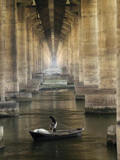 Fisherman Casts His Net in the River Ganges on the Outskirts of Allahabad, India--Photographic Print
