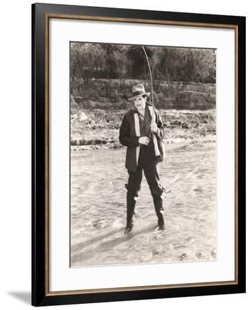 Fisherman in Waders Fishing in River--Framed Photo
