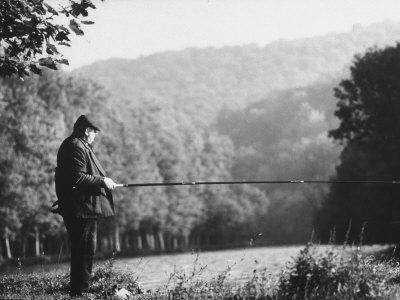 https://imgc.artprintimages.com/img/print/fisherman-on-banks-of-european-waterway_u-l-p6ijb10.jpg?p=0