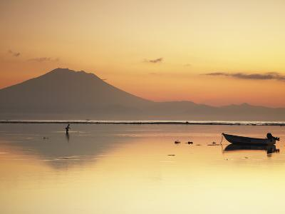 Fisherman Standing in Sea with Mount Agung in the Background, Sanur, Bali, Indonesia-Ian Trower-Photographic Print