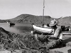 Fisherman Tends to His Nets in Greece