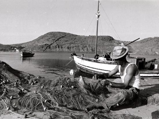 Fisherman Tends to His Nets in Greece--Photographic Print