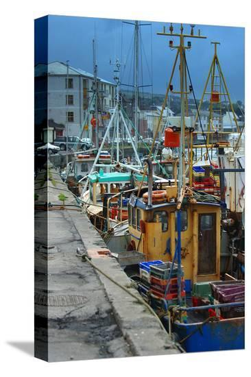 Fishermen in dock--Stretched Canvas Print