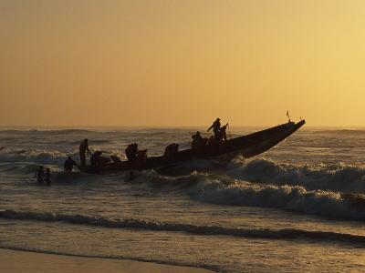 Fishermen Launch their Boat into the Atlantic Ocean at Sunset-Amar Grover-Photographic Print