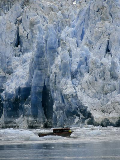 Fishing Boat Dangerously Close to a Crumbling Glacier's Edge-Paul Sutherland-Photographic Print