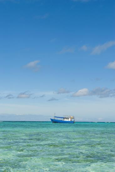 Fishing Boat in the Turquoise Waters of the Blue Lagoon, Yasawa, Fiji, South Pacific-Michael Runkel-Photographic Print