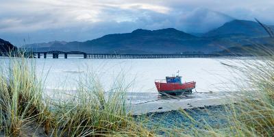 Fishing Boat with Barmouth Bridge in Background, Coast of Cardigan Bay, Gwynedd, Wales, U.K.-John Alexander-Photographic Print