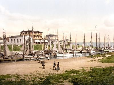 Fishing Boats Moored in Busum with Several Spa Hotels in Background--Photographic Print