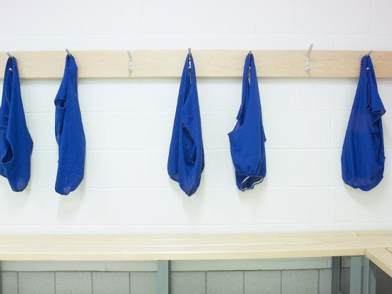 Five Blue Shirts Hanging in Changing Room of Gym--Photographic Print