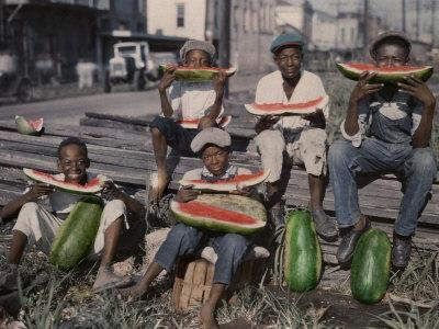 https://imgc.artprintimages.com/img/print/five-boys-sit-together-eating-large-watermelon-slices_u-l-p8jc1c0.jpg?p=0