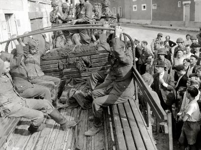 Five German Prisoners are Sitting in a Gmc Truck on Place Robert Le Fort--Photographic Print