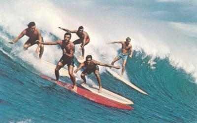 Five Surfers Catching Wave