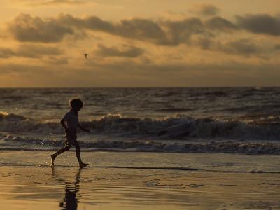 Five Year Old Boy Runs Through the Surf, Tybee Island, Georgia-Brian Gordon Green-Photographic Print