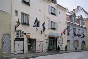 Flags on Buildings Along a Snow Covered Street, Pikk Street, Vanalinn, Tallinn, Estonia