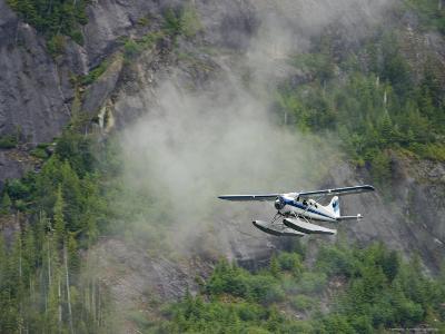 Float Plane against Granite Cliff, Alaska-Ralph Lee Hopkins-Photographic Print